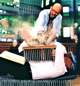 Former late-night host, Jay Leno gets in on the bed of nails trick. Photo by D. Willey, WikiMedia Commons