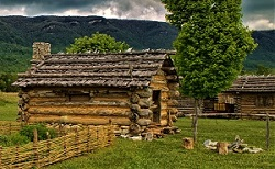 Log Cabins (reconstructed) at Martin's Station, Photo by Virginia State Parks, Wikimedia Commons
