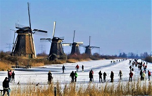 Skating by the Kinderdijk Windmills, Photo by jace48, Wikimedia Commons