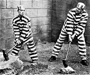 Buster Keaton (left) & Joe Roberts in Convict 13 (1920), Metro Pictures, Wikimedia Commons